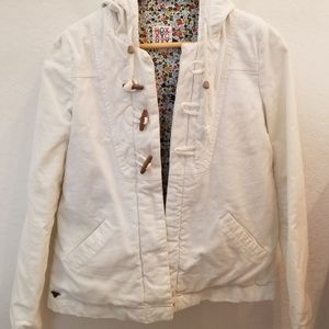 White hooded corduroy jacket with toggle detail